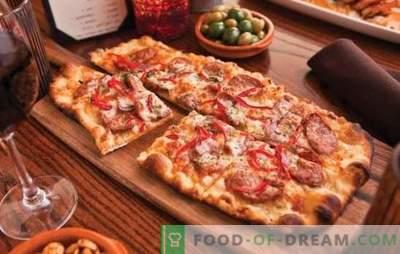 Pizza de casă: rețete cu cârnați, roșii, ciuperci, pui, castraveți. O selecție de rețete pentru pizza de casă